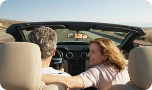 Couple in a convertible on a road